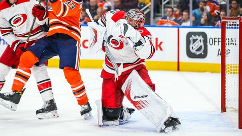 Oct 17, 2017; Edmonton, Alberta, CAN; Carolina Hurricanes goalie Cam Ward (30) makes a save against the Edmonton Oilers during the third period at Rogers Place. Carolina Hurricanes won 5-3. Mandatory Credit: Sergei Belski-USA TODAY Sports