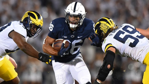 Oct 21, 2017; University Park, PA, USA; Penn State Nittany Lions running back Saquon Barkley (26) runs with the ball as Michigan Wolverines linebacker Noah Furbush (59) defends during the first quarter at Beaver Stadium. Mandatory Credit: Rich Barnes-USA TODAY Sports