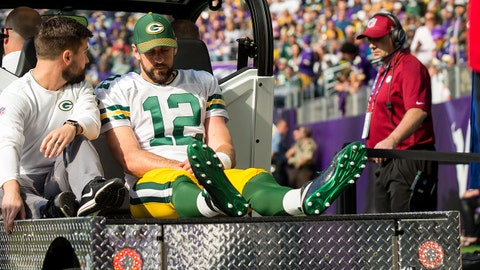 Oct 15, 2017; Minneapolis, MN, USA; Green Bay Packers quarterback Aaron Rodgers (12) is taken off the field on a cart in the first quarter against the Minnesota Vikings at U.S. Bank Stadium. Mandatory Credit: Brad Rempel-USA TODAY Sports