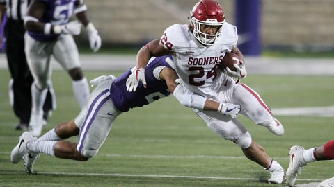 Oct 21, 2017; Manhattan, KS, USA; Oklahoma Sooners running back Rodney Anderson (24) breaks away from Kansas State Wildcats defensive back Denzel Goolsby (20) during the fourth quarter of a game at Bill Snyder Family Stadium. The Sooners won the game 42-35. Mandatory Credit: Scott Sewell-USA TODAY Sports