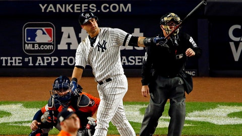 Oct 18, 2017; Bronx, NY, USA; New York Yankees catcher Gary Sanchez (24) hits a home run during the seventh inning against the Houston Astros in game five of the 2017 ALCS playoff baseball series at Yankee Stadium. Mandatory Credit: Adam Hunger-USA TODAY Sports