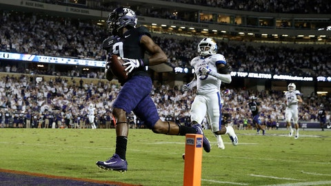 Oct 21, 2017; Fort Worth, TX, USA; TCU Horned Frogs wide receiver John Diarse (9) runs for a touchdown past Kansas Jayhawks cornerback Shakial Taylor (8) during the first half at Amon G. Carter Stadium. Mandatory Credit: Kevin Jairaj-USA TODAY Sports
