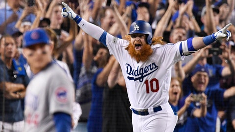 Oct 15, 2017; Los Angeles, CA, USA; Los Angeles Dodgers third baseman Justin Turner (10) runs home after hitting a three RBI home run against the Chicago Cubs in the ninth inning during game two of the 2017 NLCS playoff baseball series at Dodger Stadium. Mandatory Credit: Robert Hanashiro-USA TODAY Sports