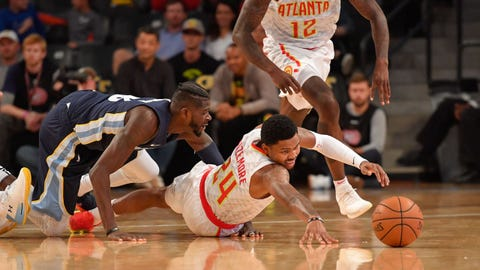 Oct 9, 2017; Atlanta, GA, USA; Atlanta Hawks forward Kent Bazemore (24) and Memphis Grizzlies forward James Ennis III (8) go after a loose ball on the court during the second half at McCamish Pavilion. Mandatory Credit: Dale Zanine-USA TODAY Sports