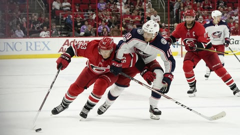 Oct 10, 2017; Raleigh, NC, USA;  Carolina Hurricanes forward Jeff Skinner (53) skates with puck against Columbus Blue Jackets forward Alexander Wennberg (10) during the second period at PNC Arena. Mandatory Credit: James Guillory-USA TODAY Sports