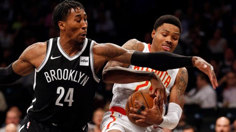 Oct 22, 2017; Brooklyn, NY, USA; Brooklyn Nets forward Rondae Hollis-Jefferson (24) battles Atlanta Hawks forward Kent Bazemore (24) for the ball during first half at Barclays Center. Mandatory Credit: Noah K. Murray-USA TODAY Sports