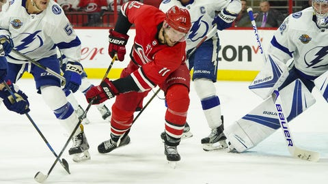 Oct 24, 2017; Raleigh, NC, USA;  Carolina Hurricanes forward Jordan Staal (11) goes after the loose puck against the Tampa Bay Lightning at PNC Arena. The Tampa Bay Lightning defeated the 5-1. Mandatory Credit: James Guillory-USA TODAY Sports
