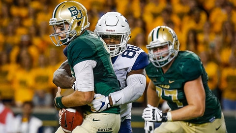 Oct 21, 2017; Waco, TX, USA; Baylor Bears quarterback Zach Smith (8) is sacked by West Virginia Mountaineers defensive lineman Adam Shuler II (88) in the first half at McLane Stadium. Mandatory Credit: Ray Carlin-USA TODAY Sports