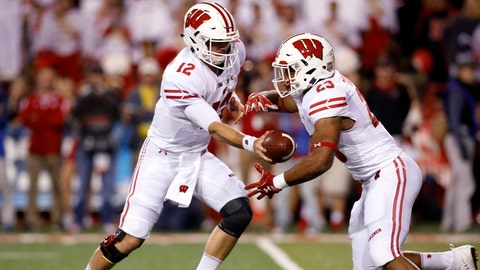 Oct 7, 2017; Lincoln, NE, USA; Wisconsin Badgers quarterback Alex Hornbook (12) hands off to running back Jonathon Taylor (23) against the Nebraska Cornhuskers in the first half at Memorial Stadium. Mandatory Credit: Bruce Thorson-USA TODAY Sports