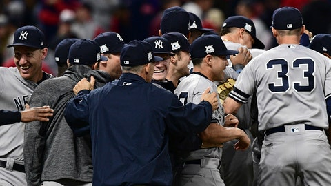 New York Yankees celebrate after the Yankees defeated the Cleveland Indians 5-2 in Game 5 of s baseball American League Division Series, Wednesday, Oct. 11, 2017, in Cleveland, to advance to the ALCS. (AP Photo/David Dermer)