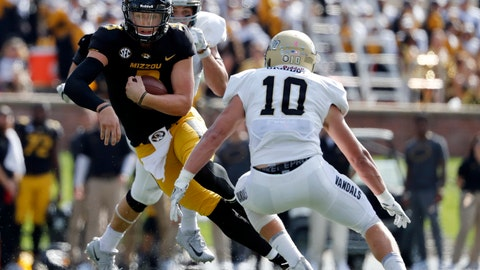 Missouri quarterback Drew Lock, left, runs with the ball past Idaho linebacker Ty Graham (10) during the second half of an NCAA college football game Saturday, Oct. 21, 2017, in Columbia, Mo. (AP Photo/Jeff Roberson)
