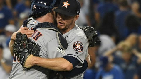 Oct 25, 2017; Los Angeles, CA, USA; Houston Astros catcher Brian McCann (16) celebrates with relief pitcher Chris Devenski (47) after the Houston Astros defeated the Los Angeles Dodgers in eleven innigns in game two of the 2017 World Series at Dodger Stadium. Mandatory Credit: Richard Mackson-USA TODAY Sports