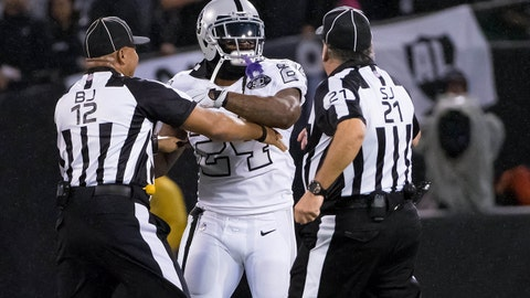 Oct 19, 2017; Oakland, CA, USA; Oakland Raiders running back Marshawn Lynch (24) in an altercation with the referees during the second quarter against the Kansas City Chiefs at Oakland Coliseum. Mandatory Credit: Kelley L Cox-USA TODAY Sports