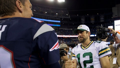 Aug 13, 2015; Foxborough, MA, USA; New England Patriots quarterback Tom Brady (12) shakes hands with Green Bay Packers quarterback Aaron Rodgers (12) after a preseason NFL football game at Gillette Stadium. Mandatory Credit: David Butler II-USA TODAY Sports