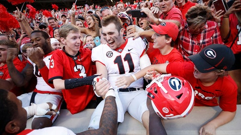 KNOXVILLE, TN - SEPTEMBER 30: Jake Fromm #11 of the Georgia Bulldogs celebrates with fans after a game against the Tennessee Volunteers at Neyland Stadium on September 30, 2017 in Knoxville, Tennessee. Georgia won 41-0. (Photo by Joe Robbins/Getty Images)