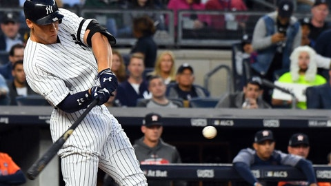 Oct 18, 2017; Bronx, NY, USA; New York Yankees right fielder Aaron Judge (99) hits an RBI double during the third inning against the Houston Astros in game five of the 2017 ALCS playoff baseball series at Yankee Stadium. Mandatory Credit: Robert Deutsch-USA TODAY Sports