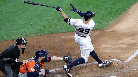 Oct 18, 2017; Bronx, NY, USA; New York Yankees right fielder Aaron Judge (99) hits an RBI double during the third inning against the Houston Astros in game five of the 2017 ALCS playoff baseball series at Yankee Stadium. Mandatory Credit: Anthony Gruppuso-USA TODAY Sports