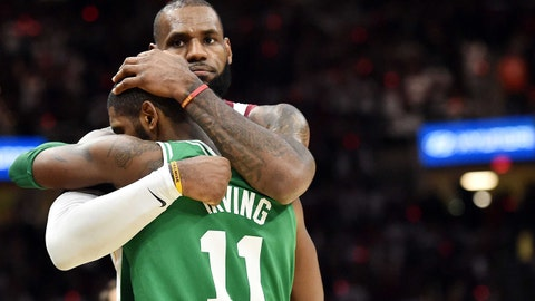 Oct 17, 2017; Cleveland, OH, USA; Cleveland Cavaliers forward LeBron James (23) and Boston Celtics guard Kyrie Irving (11) hug after the Cavs beat the Celtics 102-99 at Quicken Loans Arena. Mandatory Credit: Ken Blaze-USA TODAY Sports