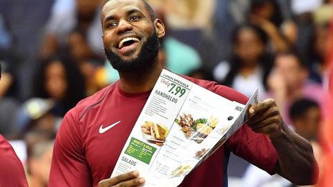 Oct 8, 2017; Washington, DC, USA; Cleveland Cavaliers forward LeBron James (23) celebrates with a menu after a dunk by Cleveland Cavaliers forward Jeff Green (not shown) against the Washington Wizards during the first half at Capital One Arena. Mandatory Credit: Brad Mills-USA TODAY Sports