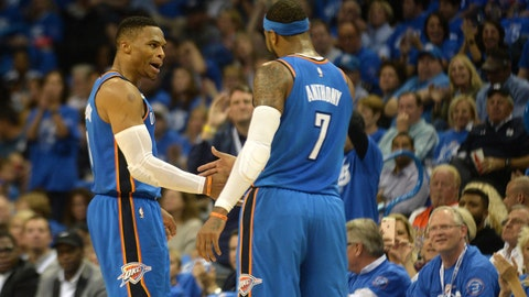 Oct 19, 2017; Oklahoma City, OK, USA;  Oklahoma City Thunder guard Russell Westbrook (0) congratulates Oklahoma City Thunder forward Carmelo Anthony (7) after a 3 point shot against the New York Knicks during the second quarter at Chesapeake Energy Arena. Mandatory Credit: Mark D. Smith-USA TODAY Sports