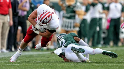 Oct 21, 2017; East Lansing, MI, USA; Indiana Hoosiers wide receiver Simmie Cobbs Jr. (1) is upended by Michigan State Spartans cornerback Justin Layne (2) during the second half of a game at Spartan Stadium. Mandatory Credit: Mike Carter-USA TODAY Sports