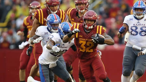 Oct 14, 2017; Ames, IA, USA; Iowa State Cyclones running back David Montgomery (32) runs away from the Kansas Jayhawks defense in the second quarter at Jack Trice Stadium. Mandatory Credit: Reese Strickland-USA TODAY Sports