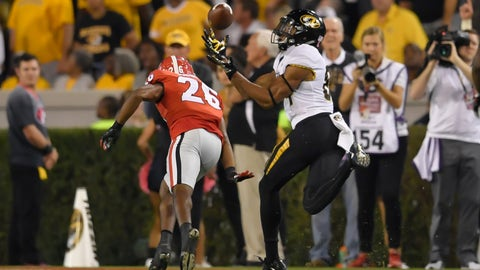 Oct 14, 2017; Athens, GA, USA; Missouri Tigers wide receiver Emanuel Hall (84) catches a touchdown pass behind Georgia Bulldogs defensive back Tyrique McGhee (26) during the second quarter at Sanford Stadium. Mandatory Credit: Dale Zanine-USA TODAY Sports