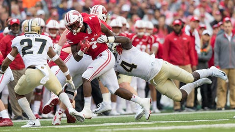 Oct 14, 2017; Madison, WI, USA; Wisconsin Badgers running back Bradrick Shaw (7) is tackled by Purdue Boilermakers linebacker Ja'Whaun Bentley (4) during the second quarter at Camp Randall Stadium. Mandatory Credit: Jeff Hanisch-USA TODAY Sports