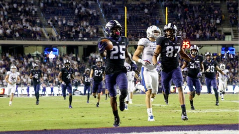 .Oct 21, 2017; Fort Worth, TX, USA; TCU Horned Frogs wide receiver KaVontae Turpin (25) returns a punt for a touchdown during the second half against the Kansas Jayhawks  at Amon G. Carter Stadium. Mandatory Credit: Kevin Jairaj-USA TODAY Sports