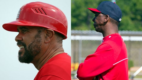 Cardinals coaches Jose Oquendo (left) and Willie McGee.