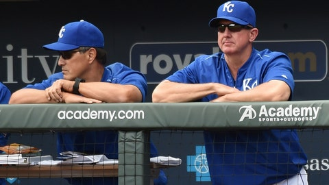 May 18, 2016; Kansas City, MO, USA; Kansas City Royals coaches Don Wakamatsu (22, left) and Dave Eiland (58) look on from the dugout against the Boston Red Sox during the fifth inning at Kauffman Stadium. Mandatory Credit: Peter G. Aiken-USA TODAY Sports