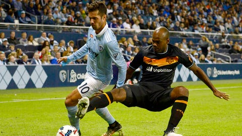 Oct 15, 2017; Kansas City, KS, USA; Sporting Kansas City midfielder Benny Feilhaber (10) defends Houston Dynamo defender Adolfo Machado (3) during the first half at Children's Mercy Park. Mandatory Credit: Jeff Curry-USA TODAY Sports