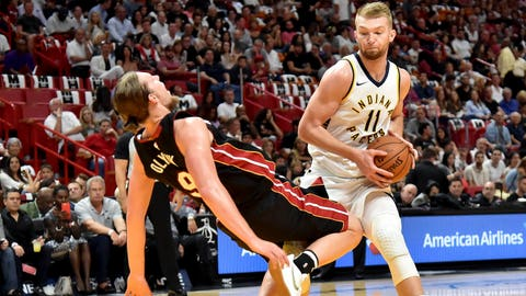 Oct 21, 2017; Miami, FL, USA; Indiana Pacers forward Domantas Sabonis (11) fouls Miami Heat center Kelly Olynyk (9) during the first half at American Airlines Arena. Mandatory Credit: Steve Mitchell-USA TODAY Sports