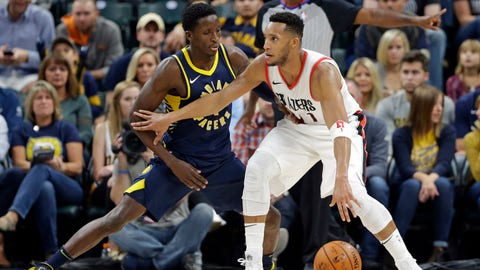 Portland Trail Blazers guard Evan Turner (1) drives on Indiana Pacers guard Victor Oladipo (4) during the first half of an NBA basketball game in Indianapolis, Friday, Oct. 20, 2017. (AP Photo/Michael Conroy)