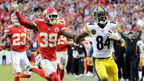 Pittsburgh Steelers wide receiver Antonio Brown (84) runs for a touchdown in front of Kansas City Chiefs defensive back Phillip Gaines (23) and defensive back Daniel Sorensen (49) during the second half of an NFL football game in Kansas City, Mo., Sunday, Oct. 15, 2017. (AP Photo/Charlie Riedel)