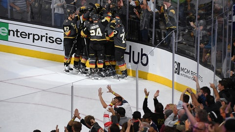 Oct 21, 2017; Las Vegas, NV, USA; Vegas Golden Knights players celebrate a game-winning overtime goal scored against the St. Louis Blues by Golden Knights center William Karlsson (71) at T-Mobile Arena. Mandatory Credit: Stephen R. Sylvanie-USA TODAY Sports