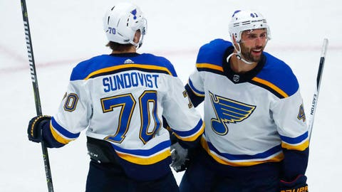 St. Louis Blues center Oskar Sundqvist, left, of Sweden, congratulates defenseman Robert Bortuzzo after his goal against the Colorado Avalanche during the third period of an NHL hockey game Thursday, Oct. 19, 2017, in Denver. St. Louis won 4-3. (AP Photo/David Zalubowski)
