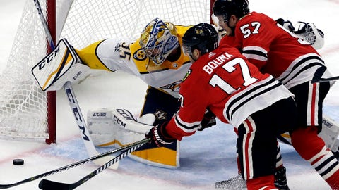 Nashville Predators goalie Pekka Rinne, left, blocks a shot against Chicago Blackhawks left wing Lance Bouma, left, and right wing Tommy Wingels during the first period of an NHL hockey game Saturday, Oct. 14, 2017, in Chicago. (AP Photo/Nam Y. Huh)