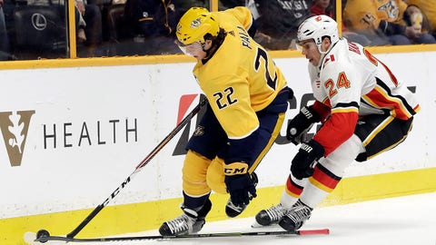 Calgary Flames defenseman Travis Hamonic (24) loses his stick as he follows Nashville Predators left wing Kevin Fiala (22), of Switzerland, in the second period of an NHL hockey game Tuesday, Oct. 24, 2017, in Nashville, Tenn. (AP Photo/Mark Humphrey)