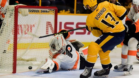 Nashville Predators forward Nick Bonino (13) scores past Philadelphia Flyers goalie Brian Elliott (37) in the second period of an NHL hockey game Tuesday, Oct. 10, 2017, in Nashville, Tenn. (AP Photo/Mike Strasinger)