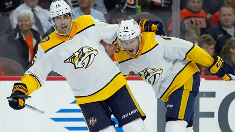 Nashville Predators' Craig Smith, left, and Colton Sissons, right, celebrate Sissons' goal during the third period of an NHL hockey game against the Philadelphia Flyers, Thursday, Oct. 19, 2017, in Philadelphia. The Predators won 1-0. (AP Photo/Tom Mihalek)p