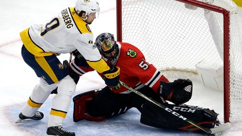 Chicago Blackhawks goalie Corey Crawford, right, blocks a shot by Nashville Predators left wing Filip Forsberg during the first period of an NHL hockey game Friday, Oct. 27, 2017, in Chicago. (AP Photo/Nam Y. Huh)