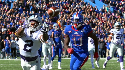 Oct 28, 2017; Lawrence, KS, USA; Kansas State Wildcats defensive back D.J. Reed (2) leaps for a pass intended for Kansas Jayhawks wide receiver Steven Sims Jr. (11) in the first half at Memorial Stadium. Mandatory Credit: Jay Biggerstaff-USA TODAY Sports