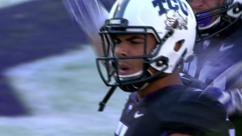 Kenny Hill stretches across the goal line to give TCU the win over WVU