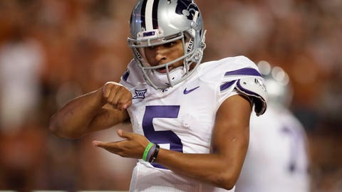Oct 7, 2017; Austin, TX, USA; Kansas State Wildcats quarterback Alex Delton (5) celebrates after scoring on a keeper against the Texas Longhorns in the third quarter at Darrell K Royal-Texas Memorial Stadium. Mandatory Credit: Erich Schlegel-USA TODAY Sports
