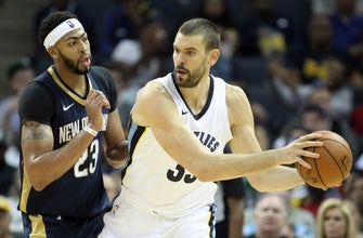Images of Pelicans drop opener to Grizzlies 103-91