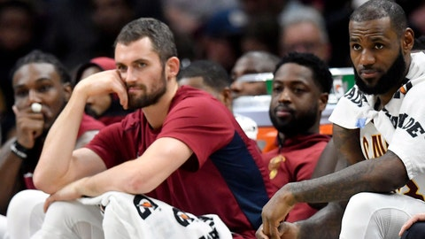 Oct 21, 2017; Cleveland, OH, USA; Cleveland Cavaliers forward LeBron James (right) watches from the bench in the fourth quarter against the Orlando Magic at Quicken Loans Arena. Mandatory Credit: David Richard-USA TODAY Sports