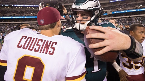 Oct 23, 2017; Philadelphia, PA, USA; Philadelphia Eagles quarterback Carson Wentz (11) greets Washington Redskins quarterback Kirk Cousins (8) on the field after a victory at Lincoln Financial Field. Mandatory Credit: Bill Streicher-USA TODAY Sports