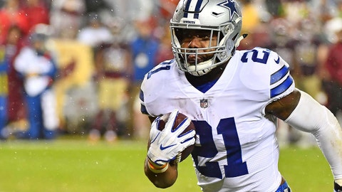 Oct 29, 2017; Landover, MD, USA; Dallas Cowboys running back Ezekiel Elliott (21) rushes the ball against the Washington Redskins during the second half at FedEx Field. Mandatory Credit: Brad Mills-USA TODAY Sports