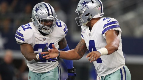 Oct 8, 2017; Arlington, TX, USA; Dallas Cowboys quarterback Dak Prescott (4) celebrates a touchdown with running back Ezekiel Elliott (21) in the fourth quarter against the Green Bay Packers at AT&T Stadium. Mandatory Credit: Matthew Emmons-USA TODAY Sports